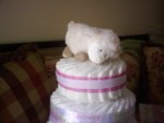 "Use a small stuffed animal as a diaper cake ""topper"""